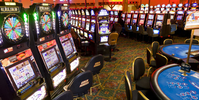 Casino Floor With Slot Machines and Blackjack Tables
